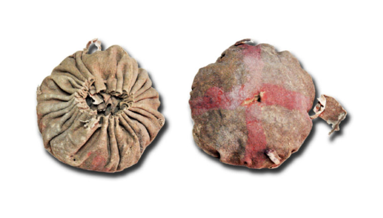 ball-like pouch from above and below. Top side has perpendicular red lines