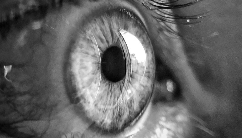 A close-up of an eye in black and white